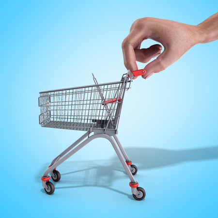 shopping cart in a hand 3d render over blue background Stock Photo