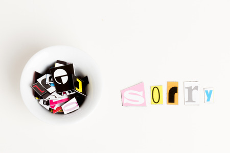 sorry: word sorry in a white background