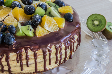 caked: half cake with chocolate and friuts