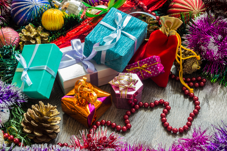 New year picture. Gifts boxes, Christmas decorations, tinsel and beads