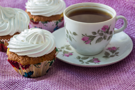 unwholesome: Muffin, decorated with whipped protein cream and cup of tea