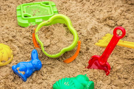 children sandbox with toys