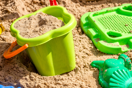 bolter: pail, sieve and molds in the sand in the sandbox, children playground Stock Photo