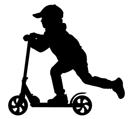 Silhouette of baby boy on scooter
