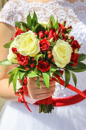 wedding bouquet in hand of bride Stock Photo