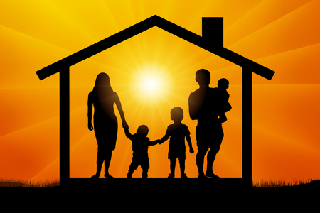 Family with three children in the house at sunset