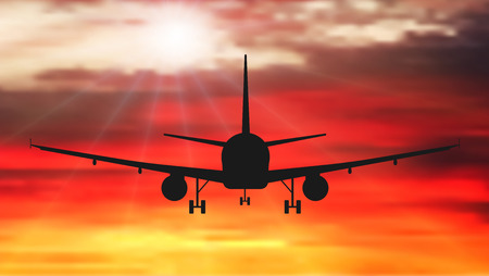 Passenger plane is flying, against the background of sunset. Airplane silhouette vector Vetores