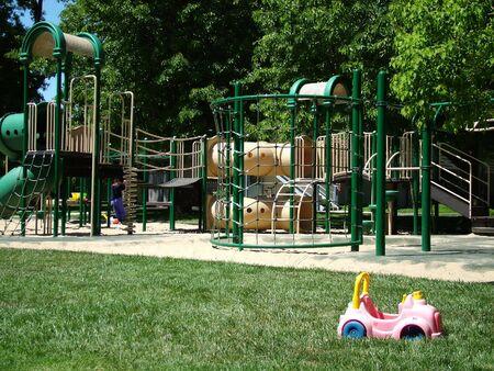 View of a childrens playground, sandbox, toy car