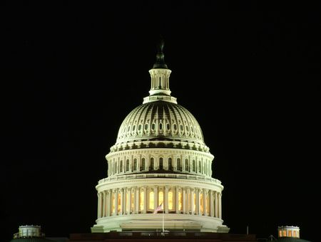 deliberation: View of a detail of the US Capitol at night Stock Photo