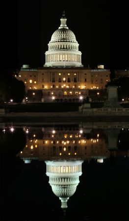 View of the Capitol and its reflection in Washington DC at night Stock Photo