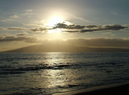 oceanic: View of an oceanic sunset with island or lan in the background