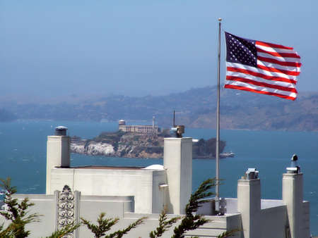 View of the island of Alcatraz from San Franciscow, American flag photo