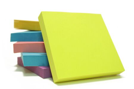 Stack,post its, isolated over white with a blank post it up front Stock Photo