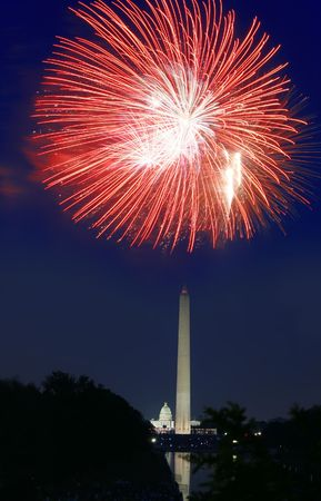 View of the 4th of July Fireworks in Washington DC, fireworks over the Washington Monument with a view of the Capitol in the background Фото со стока