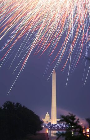 View of the 4th of July Fireworks in Washington DC, fireworks over the Washington Monument with a view of the Capitol in the background Stock Photo