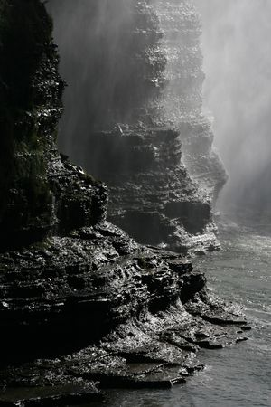 rock bottom: Sunlit rock formations at sunset, bottom of the upper waterfall at Letchworth state park