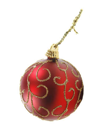 Red Christmas ornament isolated over white, suitable for holiday, new year, or christmas related designs