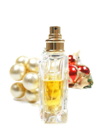 christmas perfume: Perfume as a Christmas, New Years gift. Isolated over white in a set up with hoiday decorations and ornaments.