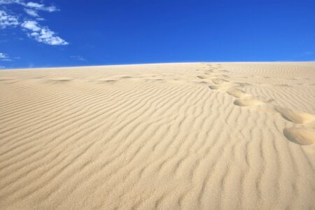 Amazing view of sand dunes against deep blue sky, clear, versatile stock image photo