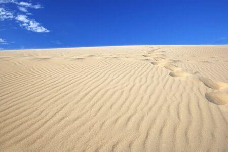 versatile: Amazing view of sand dunes against deep blue sky, clear, versatile stock image