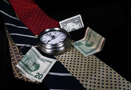 Clock, money, ties, dollar bills - still life representing gender/male related concepts