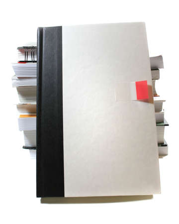 versatile: View of a blank white book cover, facing the viewer leaning against a stack of books. Versatile image for design, advertising, educational projects Stock Photo