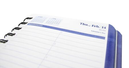 View of a blank page in a daily planner with the valentines day date