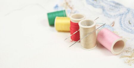 Embroidery, sewing background suitable for a banner or a header or a page-width design