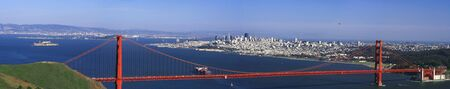 alcatraz: Panoramic shot of the Golden Gate Bridge in San Francisco with the view of the city, the bay and Alcatraz in the background Stock Photo