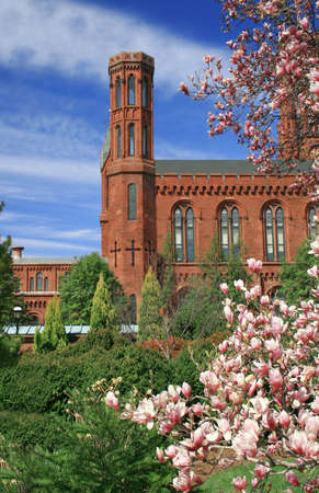 Scenic view of the Smithsonian Castle, landmark on the Mall, Washington DC, view from the garden through cherry blossoms