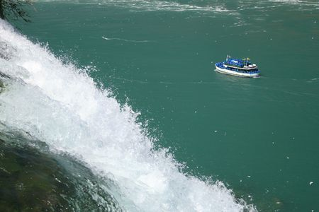 amazing stunning: Scenic view of Niagara falls with boat full of tourists going to see the Horseshoe Bend falls