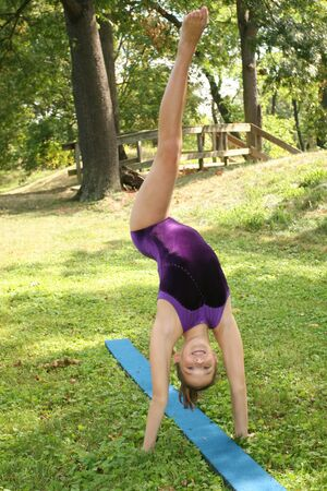 Girl doing a gymnastics exercise  workout in a park