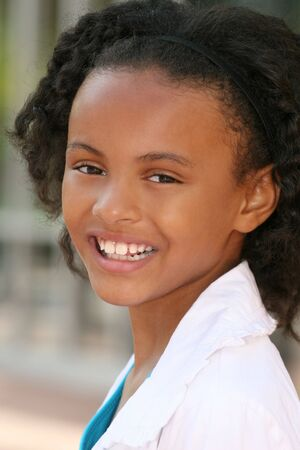 approachable: Smiling, friendly, african american teenager girl, portrait Stock Photo