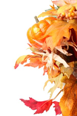 Still life with fall leaves and pumpkin isolated over white, suitable for seasonal, thanksgiving or halloween designs