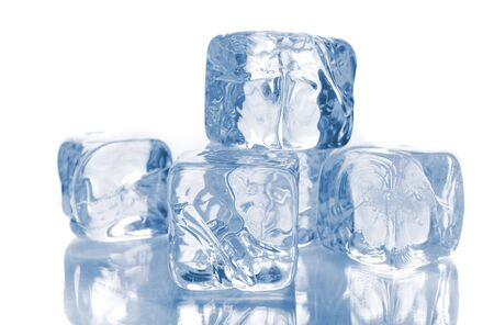 Blue ice cubes isolated over white background with reflections Stock Photo