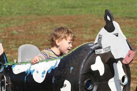 hayride: Child having fun on a farm ride Stock Photo