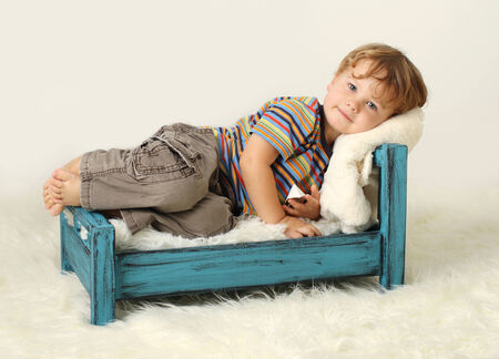 Child toddler on bed, awake, sleeping concept