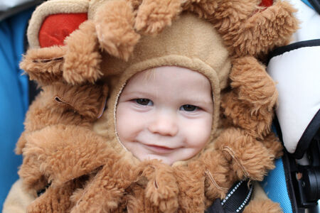 Baby, child in a lion halloween costume Foto de archivo