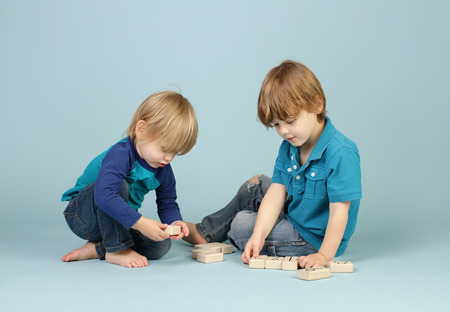 Children playing with blocks, kids playtime and sharing