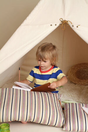 teepee: Child playing at home indoors with a teepee tent Stock Photo
