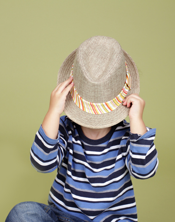 Kids, children clothing and fashion. Happy boy with a fedora hat, posing and having fun