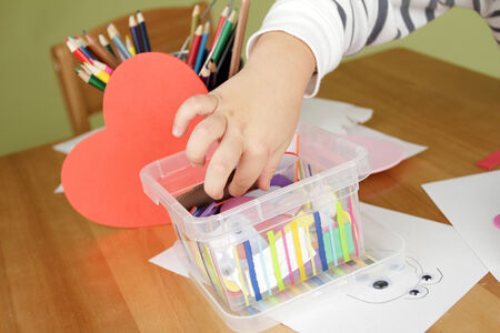 Child, kid engaged in arts and crafts activity, creative learning and education concept