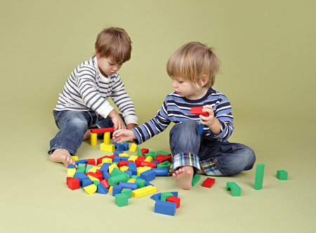 Kids, children, sharing, playing nicely together, teamwork and cooperation concept Imagens