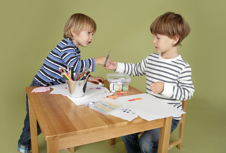 Child, kid engaged in arts and crafts activity, sharing and learning concept Фото со стока