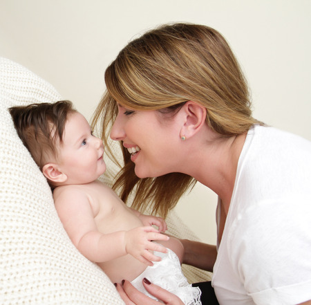 Mother Playing with Newborn Baby, Happy Laughing and Smiling