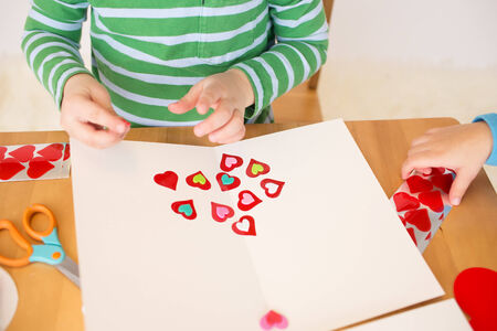 peek a boo: Childs, kids, engaged in a Valentine Stock Photo