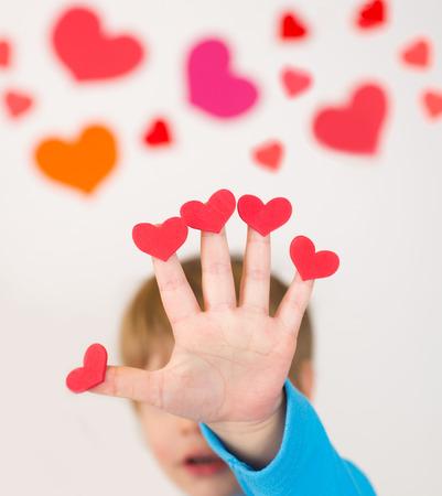 holding up: Child, holding up valentine
