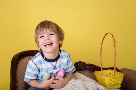 egg hunt: Child playing with an easter egg basket, easte egg hunt concept.