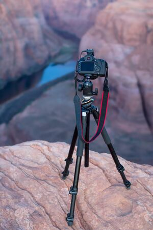 DSLR camear on a tripod overlooking the canyon and the Colorado river at Horseshoe Bend, in Page, Northern Arizona