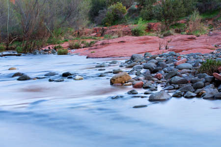 az: View of red rocks and river at the foot hills of the famous Castle Rock in Sedona, Arizona, AZ, an American landmark